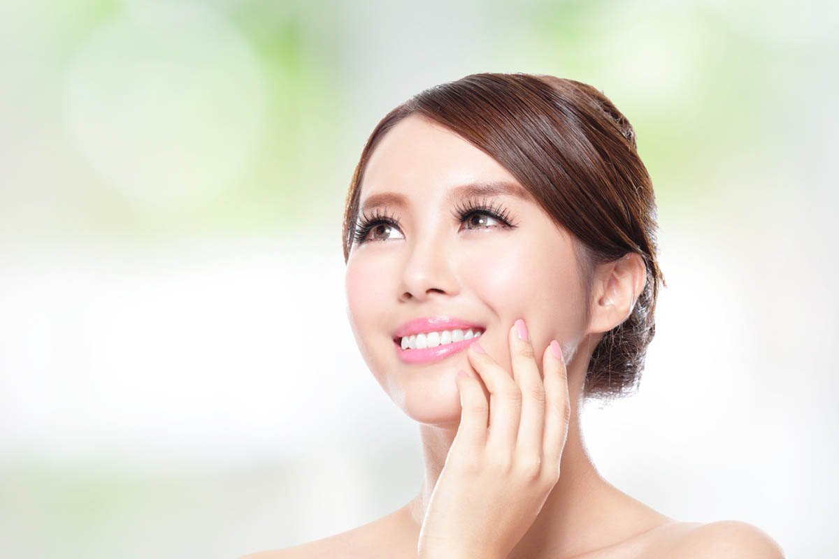Smiling woman with perfect skin