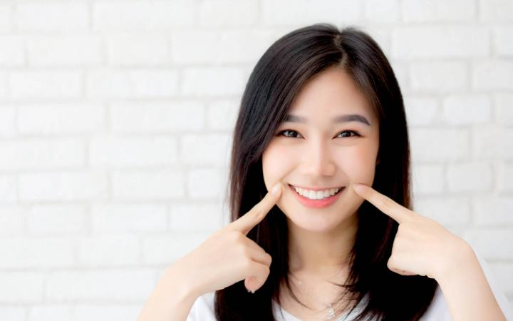 asian woman with a beautiful smile